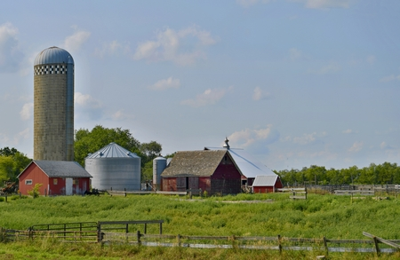 Modern Farm in Nebraska with barn, silo and field