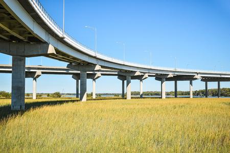 Long raised concrete bridge crossing marsh