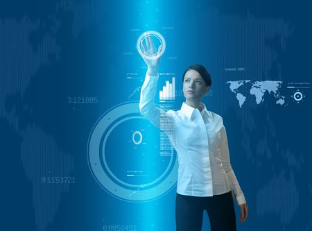 Attractive brunette young woman in futuristic interface (business people in virtual space photo collages series) photo