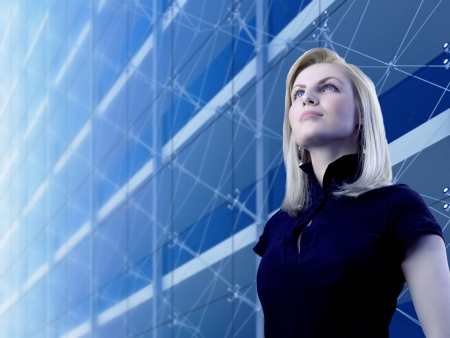 tendency: Attractive blonde standing by the skyscraper (outstanding business people in interiors  interfaces series)