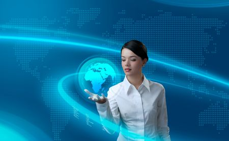 future space: Attractive brunette holding virtual globe (outstanding business people in interiors  interfaces series) Stock Photo