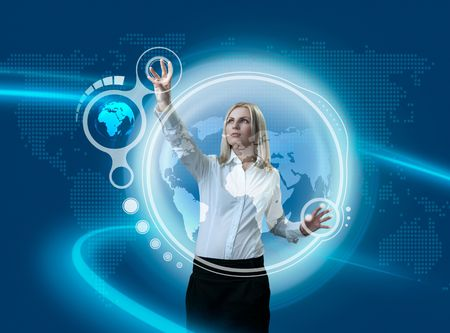 virtual office: Future Globe Interface Navigating By Attractive Blonde (outstanding business people in interiors  interfaces series) Stock Photo