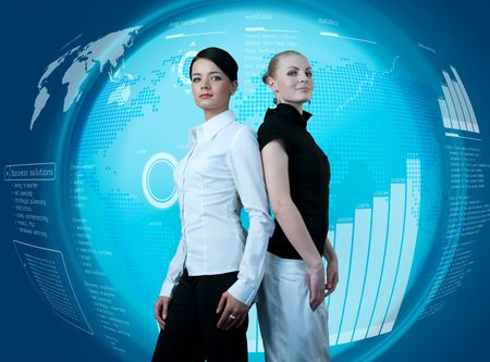 Attractive couple of businesswomen in futuristic interface (outstanding business people in interiors  interfaces series)