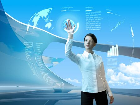 Attractive brunette with interface in futuristic interior (outstanding business people in interiors  interfaces series)