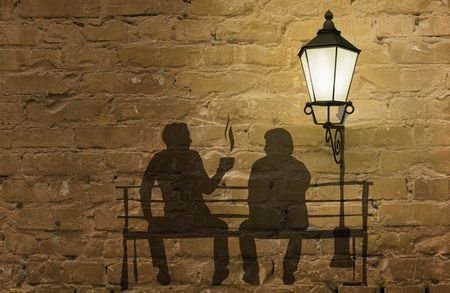 Two silhouettes on a bench (coffee story art on the wall series) Stock Photo - 6667171