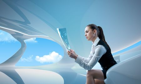 virtual office: Sexy businesswoman examining future digital report  newspaper (outstanding business people in interiors  interfaces series) Stock Photo