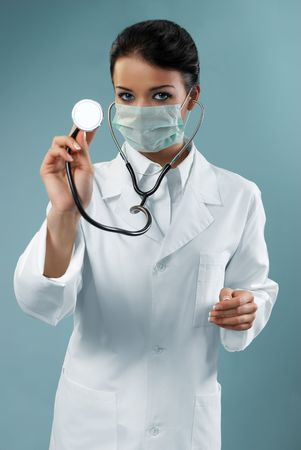 Pretty doctor examining with stethoscope (modern healthcare / medical people in studio series) Standard-Bild