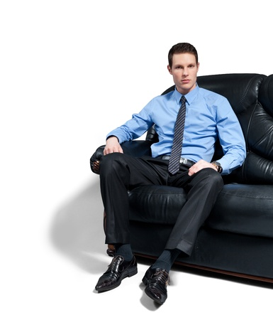 sofa: Young attractive bossy businessman sitting on the sofa.