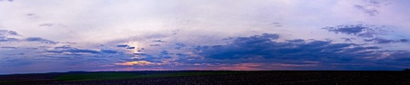 Extremely wide sunset over field panorama photo
