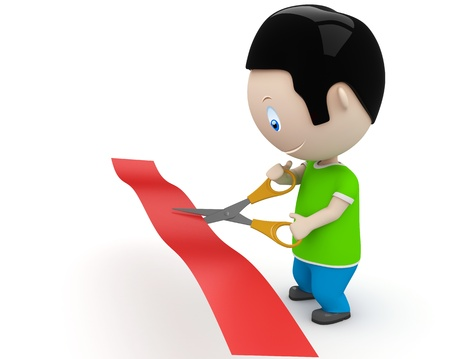 young man cutting red line with scissors.  photo