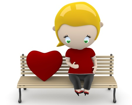 preagnant woman on a bench with heart sign. photo