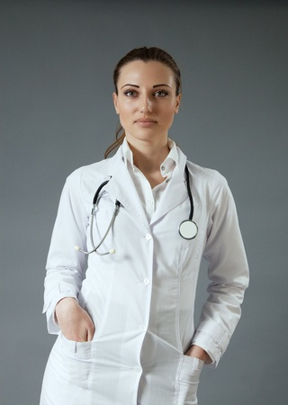 sexy female doctor: Sexy doctor. Modern healthcare  medical people in studio collection. Stock Photo