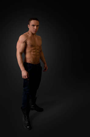 breast pocket: Sexy naked torso fit and neat young man studio full portrait  Wearing dark blue jeans and black boots  Fit and neat collection