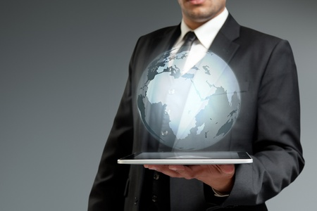 virtual assistant: World technology communication concept. Globe from tablet pc. Touch pad interface collection. Stock Photo