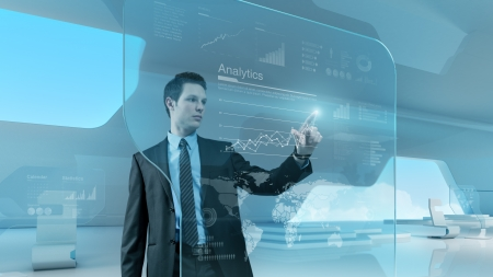 virtual office: Future technology touchscreen interface  Man touching screen interface in hi-tech interior Businessman  drawing chart in futuristic office  Stock Photo
