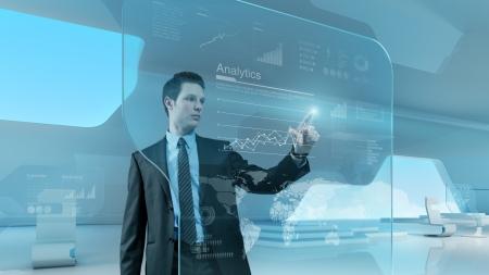 Toekomstige technologie touchscreen interface Mens wat betreft het scherm interface in hi-tech interieur Zakenman tekening grafiek in futuristische kantoor