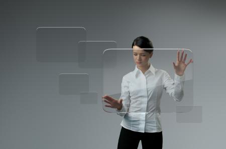 Girl touching transparent screen interface Stock Photo - 18411361