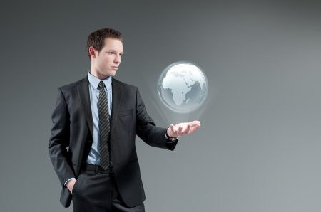 virtual man: Man holding world globe Hologram.Future interface. Futuristic technology concept.Global business management.