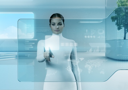 virtual office: Future technology touchscreen interface.Girl touching screen interface in hi-tech interior.Business lady pressing virtual button in futuristic office. Stock Photo
