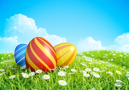 Easter Greeting Card Background with decorated Easter eggs on meadow with grass and flowers  photo