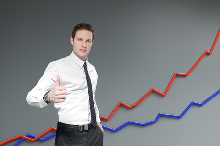 Financial report   statistics  Business success concept  Businessman shows thumb up with growth progress graph on background  photo