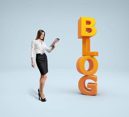 bunner: Business lady with tablet pc stands near word blog  Idea concept