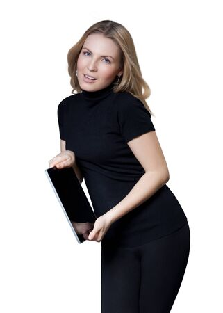 skintight: Sexy blond girl in black skintight garments holding tablet pc  Isolated  Stock Photo