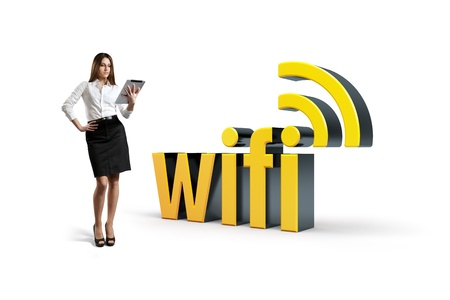 Businesswoman stands with tablet pc by the wifi word  Isolated  photo