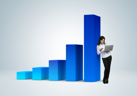 Financial report   statistics  Business success concept  Business woman with notebook stands by the bar graph