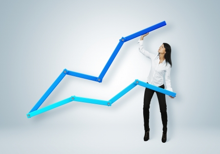 Financial report   statistics  Business success concept  Businesswoman helping chart arrow to go upward  photo