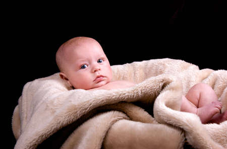 3 month old baby boy lying on a fluffy blanket with a black background Stock Photo - 6826053