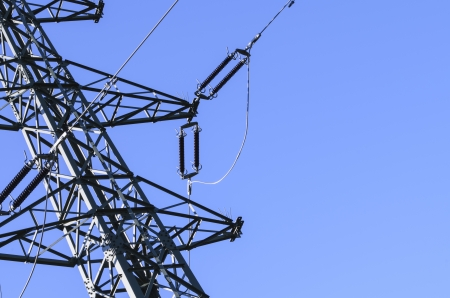 High voltage electric pylon with blue sky background  Stock Photo