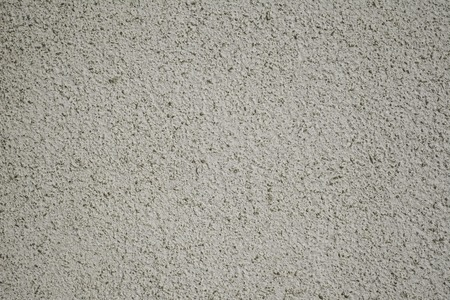 Concrete texture with small stones parts inside.