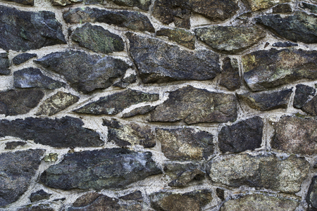Detail of a stone wall with different size of rock.