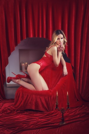 red corset: Attractive sexy girl wearing red corset Stock Photo