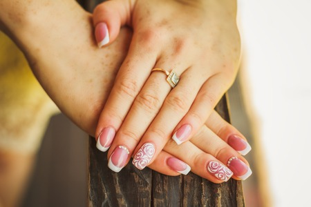 Close-up wedding nail art with roses