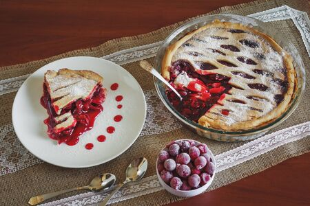friut: Slice of friut pie with cherries in white plate
