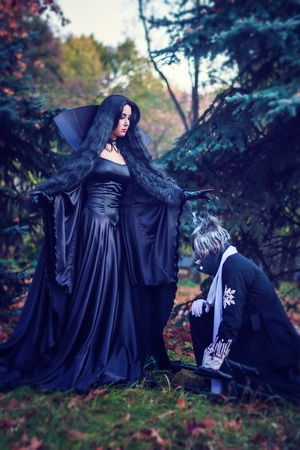wiccan: Mystery witch and her vassal on the halloween