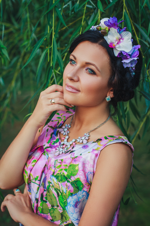 coronet: Young attractive smiling woman with coronet of beads