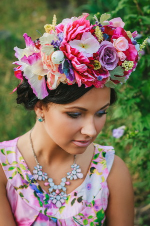 coronet: Young attractive woman with coronet of flowers with closed eyes