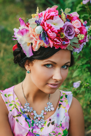 coronet: Young attractive woman with coronet of flowers looking to the camera