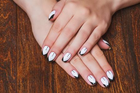 naildesign: Black and white  nail art on dark wooden background