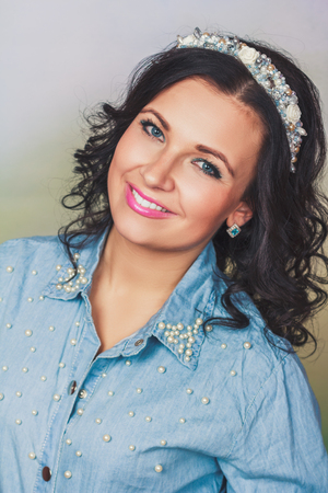 coronet: Attractive woman with coronet of beads in blue jeans shirt Stock Photo