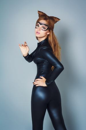 stage costume: Young woman in latex and leather black cat costume Stock Photo