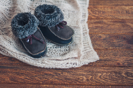 bootees: Warm babys bootees with on dark background
