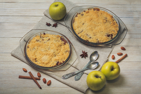 apple crumble: Apple crumble on the wooden background with green apples