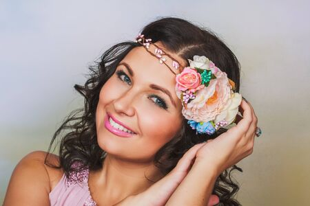 brunnet: Beautiful brunnet woman with pink flower wreath