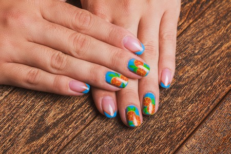 Summer French Blue Nail Art With Painted Orange Fruit On Wooden