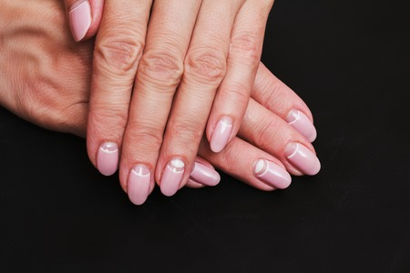 White And Pink Nail Art On The Black Background Stock Photo Picture