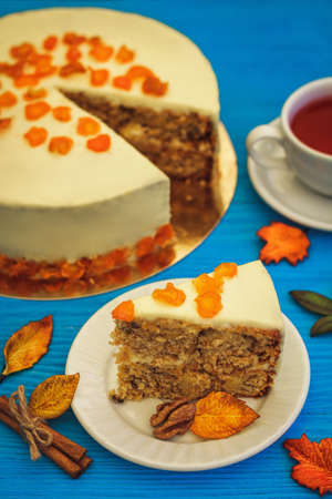 red tea: Carrot cake with red tea on blue wooden background Stock Photo